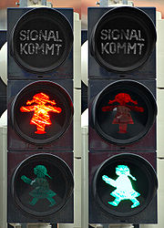 German crosswalk signal showing a female pictogram