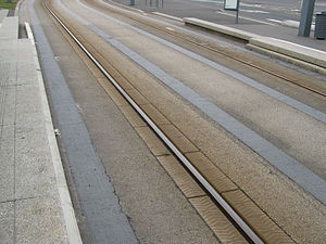 "Bombardier Guided Light Transit - A central rail embedded in the road guides GLT vehicles while they are in their ""tram-like"" mode."