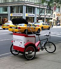 A cycle rickshaw at rest in Manhattan.