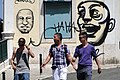 Trio of Young Men against Graffitied Backdrop - Lisbon, Portugal (4633426432).jpg