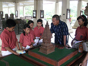 Education in Indonesia - The students pictured above are listening to a guide at the Trowulan Museum, East Java whilst examining a model of the Jawi temple.