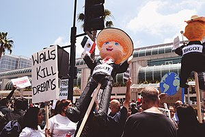 "Timeline of protests against Donald Trump - An effigy seen in San Diego on show of May 26, 2016, featuring Trump with the word ""Bigot"" taped on while wearing a sombrero and holding a Mexican flag"