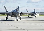 Two F-35C Lightning II from VFA-125 taxi across the flight line at NAS Lemoore on 25 January 2017.JPG