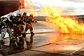 U.S. Air Force firefighters suppress a fire during a training exercise at Spangdahlem Air Base, Germany, Jan. 8, 2014 140108-F-OP138-193.jpg