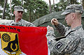 U.S. Army paratroopers with Alpha Troop, 1st Squadron, 91st Cavalry Regiment, 173rd Infantry Brigade Combat Team prepare to hoist the squadron flag during exercise Steadfast Jazz 2013 in the West Pomeranian 131025-A-IK450-512.jpg