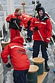 U.S. Coast Guard seamen aboard the national security cutter USCGC Bertholf (WMSL 750) scrub the deck on the ship's fantail during Arctic Shield 2012 in the Arctic Ocean Sept 120913-G-VS714-249.jpg