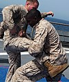 U.S. Marine Corps Cpl. Jawahn Brown, right, with Security Cooperation Task Force Africa Partnership Station (APS) 2012, practices Marine Corps Martial Arts Program techniques on the flight deck of the amphibious 120804-M-JU449-125.jpg