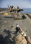 U.S. Marine Corps Cpl. Kyle N. Runnels, foreground, a combat correspondent with the 26th Marine Expeditionary Unit (MEU), records video of Marines assigned to a low-altitude, air-defense platoon with Marine 131002-M-SO289-008.jpg