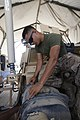 U.S. Marine Corps Lance Cpl. Sibert R. Melara, a vehicle recovery operator with Marine Wing Support Squadron 271, changes the air filter of a mine-resistant, ambush-protected all-terrain vehicle at Camp 130401-M-BU728-104.jpg