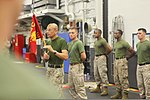 U.S. Marine Corps Sgt. Maj. Octaviano Gallegos, left, the sergeant major of the 24th Marine Expeditionary Unit, speaks to the participants of the Warrior of the Month event in the hangar bay of amphibious 120501-M-RO494-006.jpg