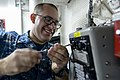 U.S. Navy Interior Communications Electrician 3rd Class Jonathan Hart performs maintenance on an integrated voice communication system terminal aboard the guided missile cruiser USS Monterey (CG 61) Nov. 12 131112-N-QL471-027.jpg