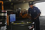 U.S. Navy Machinist's Mate 3rd Class Tabasha Harden moves barrels in the hangar bay of the aircraft carrier USS Dwight D. Eisenhower (CVN 69) Aug. 20, 2013, at Naval Station Norfolk, Va 130820-N-MD211-004.jpg