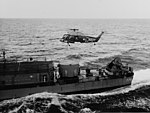 UH-2A Seasprite of HU-2 hovers over stern of USS Douglas H. Fox (DD-779) in August 1964.jpg