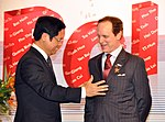 USAID Mission Director Francis Donovan receives award from VCCI Chairman Vu Tien Loc at the Provincial Competitiveness Index 2011 Launch (6924752771).jpg