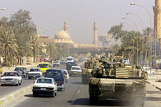 Battle of Baghdad (2003) - A Marine Corps M1 Abrams tank patrols a Baghdad street after its fall in 2003 during Operation Iraqi Freedom.