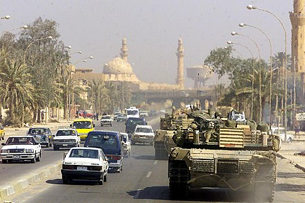 A Marine Corps M1 Abrams tank patrols a Baghdad street after its fall in 2003 during Operation Iraqi Freedom. USMarineTankinBaghdad.jpg