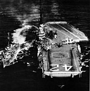 USS Franklin D. Roosevelt (CVA-42) refueling USS Clarence K. Bronson (DD-668), circa in July 1956