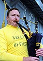 US Navy 021024-N-5555F-004 Cmdr. Jeffrey Wolf plays the bagpipes.jpg