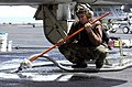 US Navy 030414-N-9319H-005 Airman Apprentice Jimmy Zayas from San Antonio, Texas, vacuums out water from a pad eye.jpg