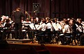 US Navy 031219-N-2101W-001 A band director for U.S. Seventh Fleet Band conducts a Christmas concert at the Fleet Theater with the Zushi High School Band.jpg
