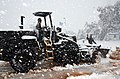 US Navy 040213-N-0780F-082 Equipment Operator Constructionman Travis Brant, of Summerset, Pa., operates a front-end loader to clear snow.jpg