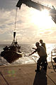 US Navy 040708-N-6932B-033 Ship's Boatswain, Chief Warrant Officer 3 Vincent Langley oversees the launching of a 24-foot Rigid Hull Inflatable Boat (RHIB) from High-Speed Vessel Swift (HSV 2).jpg