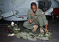 US Navy 041110-N-4374S-002 Aviation Warfare Systems Operator 3rd Class Lloyd Goodison, assigned to the Proud Warriors of Helicopter Anti-Submarine Squadron Light Four Two (HSL-42), inspects his flight vest.jpg