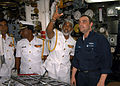 US Navy 050221-N-4702D-060 Machinist Mate 1st Class Michael A. Hohn shows the Commander of the Sri Lanka Navy, Vice Adm. D.W.K. Sandagiri, the different equipment a Sailor must monitor while on watch.jpg