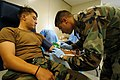 US Navy 050712-N-2385R-014 U.S. Army Spc. John Reed, a member of the Armed Services Blood Program, draws blood from a U.S. Navy blood donor.jpg