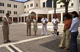 Moment of silence - Naples, Italy (July 14, 2005) – Navy Chaplain Dave McBeth, left, leads an informal gathering of personnel aboard Naval Support Activity (NSA) Naples during a Europe-wide coordinated two-minute moment of silence held throughout the European Union in relation to the 2005 London Bombings.