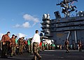 US Navy 050906-N-9362D-002 Sailors participate in a Foreign Object Debris (FOD) walk down on the flight deck aboard the Nimitz-class aircraft carrier USS Theodore Roosevelt (CVN 71) prior to flight operations.jpg