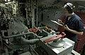 US Navy 060616-N-9851B-012 Engineman Fireman Tiffany Bailey documents engineering checks in the number one main machinery room aboard the amphibious dock landing ship USS Tortuga (LSD 46).jpg