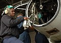 US Navy 070222-N-2491R-039 Aviation Electronics Technician 3rd Class Kevonte Daniels, assigned to the Mad Foxes of Patrol Squadron Five (VP-5), cleans an engine part during a quarterly Isochronal Scheduled Inspection System (IS.jpg