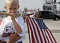 US Navy 070703-N-5330L-021 A young boy waits for his grandfather to arrive aboard guided-missile destroyer USS Nitze (DDG 94) as ships of Bataan expeditionary Strike Group (ESG) returned home after their six-month deployment.jpg