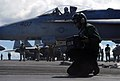 US Navy 070808-N-0890S-021 Airman Sebastian Villegas displays the weight of an F-A-18C Hornet, assigned to the.jpg