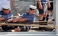 US Navy 071025-N-4965F-008 Sailors aboard British Royal Navy frigate HMS Monmouth (F235) perform line handling duties as the ship moors pierside Naval Station Pearl Harbor