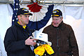 US Navy 080125-N-2510R-006 Former President George H. W. Bush receives a cowboy-style hard hat and a yellow-shooter shirt from the commanding officer of Precommissioning Unit (PCU) George H. W. Bush (CVN 77), Capt. Kevin O'Flah.jpg