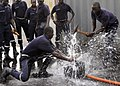 US Navy 080726-G-2443T-002 Firefighters from the Dakar Marine Terminal fire department practice plugging a hole during a damage control training exercise.jpg