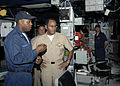 US Navy 080815-N-1713L-082 Operations Specialist 1st Class Tyrone Barlow briefs Vice Adm. Mel G. Williams Jr., commander, U.S. Second Fleet, on the capabilities of the combat information center.jpg
