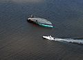 US Navy 080919-N-6575H-703 In this aerial photograph, a capsized boat is seen adrift in Galveston Bay.jpg