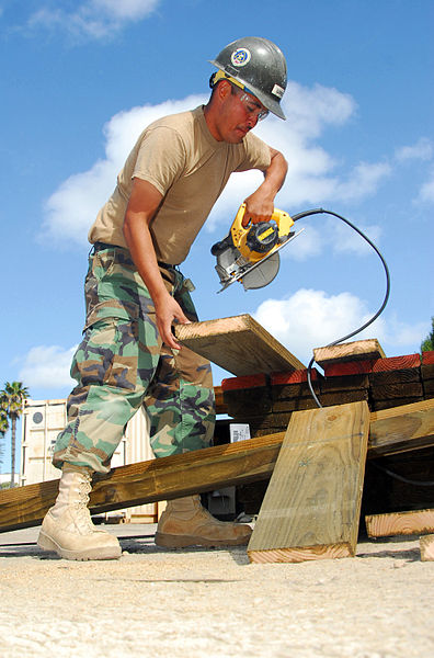 File:US Navy 090305-N-5617R-002 Builder 3rd Class Joseph Lopez cuts a piece of wood.jpg