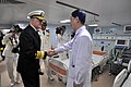 US Navy 090420-N-8273J-461 Chief of Naval Operations (CNO) Adm. Gary Roughead speaks with doctors aboard the People's Liberation Army Navy type 920 hospital ship Daishandao (AHH 866).jpg