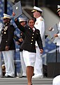 US Navy 100528-N-3857R-337 A Marine Corps graduate from the U.S. Naval Academy Class of 2010 celebrates after receiving her diploma during the 2010 graduation and commissioning ceremony.jpg