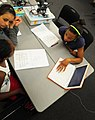US Navy 100623-N-6046S-115 Students participating in the two-week MySTEM summer program look up building codes for an upcoming project at Naval Support Activity Mid-South.jpg