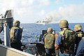 US Navy 101027-N-1854W-179 ailors aboard the guided-missile destroyer USS Mitscher (DDG 57) fire a .50-caliber machine gun at the ex-USNS Saturn du.jpg