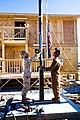 US Navy 101203-N-6383T-376 teel Worker 1st Class Steven Bamba, left, and Steel Worker 1st Class John Overy install a new flag mast at Kandahar Air.jpg