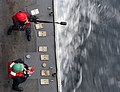 US Navy 101214-N-6006S-048 A Sailor aboard the guided-missile cruiser USS Bunker Hill (CG 52) fires a shot line.jpg