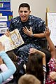 US Navy 110302-N-HW977-168 Lt. William Schindele reads Duck For President to students at Clara Barton Elementary School during an annual Read Acros.jpg