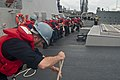 US Navy 111107-N-EA192-025 Sailors assigned to the guided-missile destroyer USS Mustin (DDG 89) heave a line during a replenishment at sea.jpg