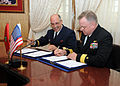 US Navy 120202-N-ON468-065 U.S. and Moroccan senior leadership sign documents at the conclusion of a command briefing.jpg